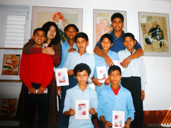 "Yumi with students at her solo show ""Living Tradition"" in Kathmandu, Nepal, 1999"